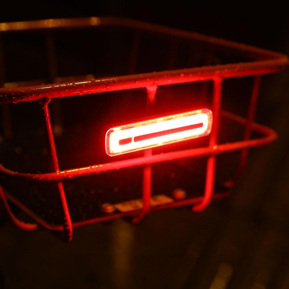 red and flashing bicycle tail light